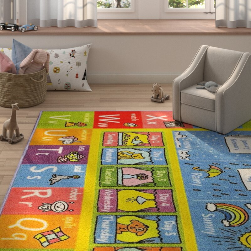 Zoomie Kids Weranna ABC Seasons Months and Days of the Week Educational Learning Blue/Yellow Indoor/Outdoor Area Rug