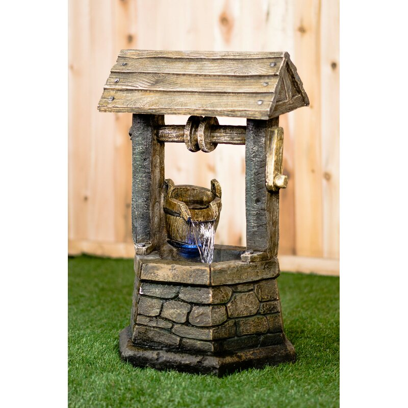 hi line gift ltd resin wishing well with pouring bucket lighted