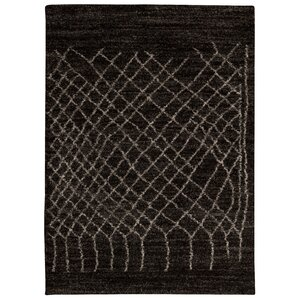 Strassen Black Area Rug