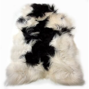 Reviews Emalie Long-Haired Hand-Woven Sheepskin Black/White Area Rug By House of Hampton