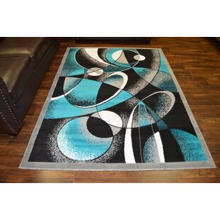 Cothern Turquoise Black Area Rug