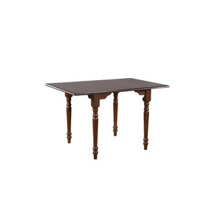 Kenya Drop Leaf Solid Wood Dining Table by August Grove