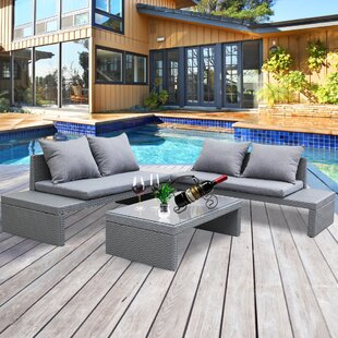 Colvin Outdoor 4 Piece Rattan Conversation Set with Cushions