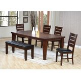 Extendable Solid Wood Dining Table by Charlton Home®