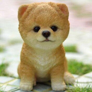 Sitting Pomeranian Puppy Statue