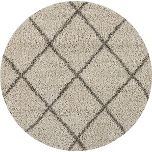 Travers Ivory Area Rug by Orren Ellis