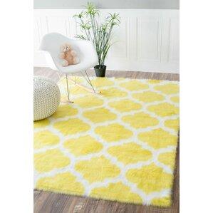 Rosemarie Faux Sheepskin Yellow Area Rug