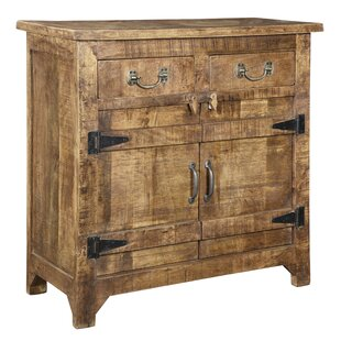 Alaska Mango Wood Accent Cabinet by World Menagerie