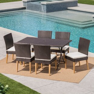 Ivy Bronx Bickel Outdoor Wicker 7 Piece Dining Set with Cushions