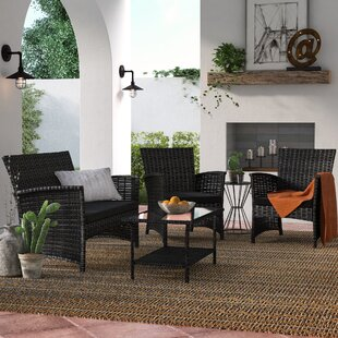 Baner Garden 4 Piece Rattan Sofa Seating Group with Cushions