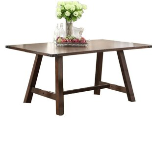 Gonsalves Simply Trimmed Dining Table