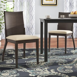 Mayela Genuine Leather Upholstered Dining..