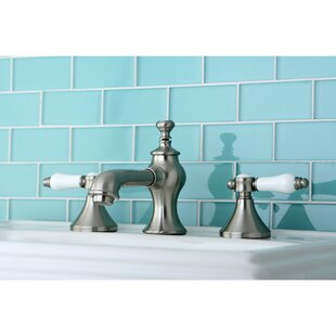 Vintage Widespread Bathroom Faucet with Pop-Up Drain by Kingston Brass