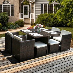 Komar 9 Piece Dining Set with Cushions by..