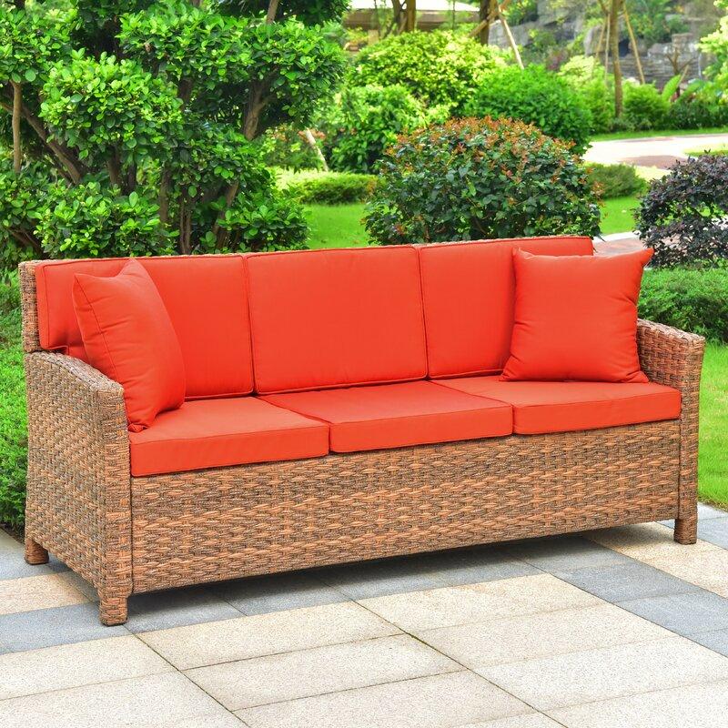 deanna resin wicker patio sofa with cushions joss main rh jossandmain com resin wicker sofa sets patio wicker sofa