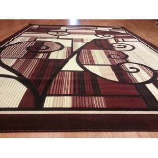 Hand-Carved Red Area Rug byRug Tycoon