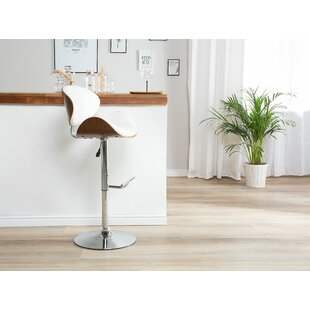 Colne Faux Leather Adjustable Height Swivel Bar Stool by Wrought Studio
