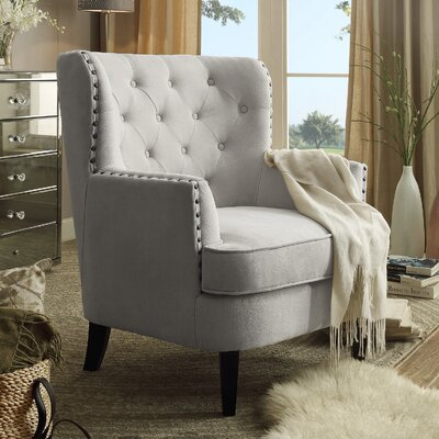 Save To Idea Board. Beige Chrisanna Wingback Chair