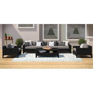 Stivers 7 Piece Rattan Sectional Seating Group with Cushions