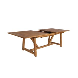 Strange Solid Wood Dining Table by Loon Peak