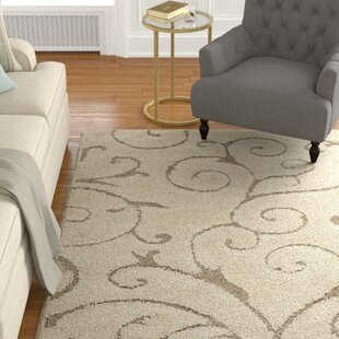 Look for Henderson Cream Area Rug by Alcott Hill