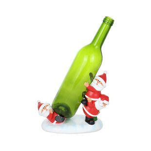 Tumbling Trio of Santa Clauses 1 Bottle T..