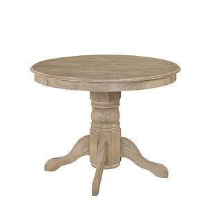 Brayan Pedestal Dining Table Ophelia & Co.
