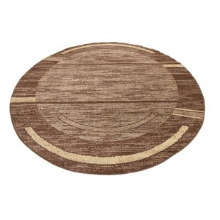 Bryan Stain-resistant Brown Area Rug by Ebern Designs