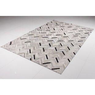 Affordable Price Malloy Cowhide Black/Gray Area Rug ByOrren Ellis
