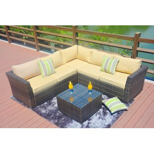 Latitude Run Messick4 Piece Rattan Sectional Seating Group with Cushions