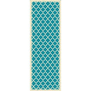 Houck Quaterfoil Teal/White Indoor/Outdoor Area Rug