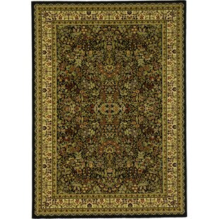 Look for Issil Black Area Rug By World Menagerie