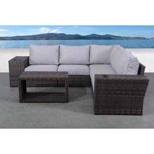Cochran 8 Piece Rattan Sectional Seating Group with Cushions