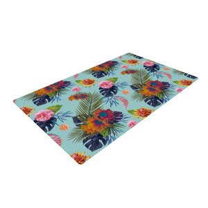 Nika Martinez Tropical Floral Blue Area Rug
