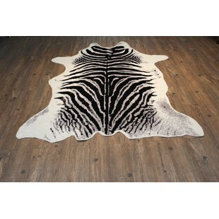 Find for Faux Cowhide Black/White Area Rug ByRug Factory Plus