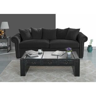 Kassik Faux Upholstered Coffee Table with Storage