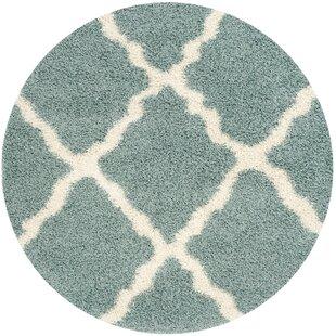 Charmain Flokati Blue/Ivory Area Rug by Willa Arlo Interiors