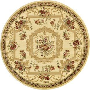 Crainville Cream Area Rug by Charlton Home