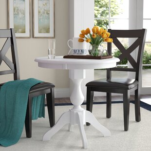 Jane Street Solid Wood Dining Table by Charlton Home