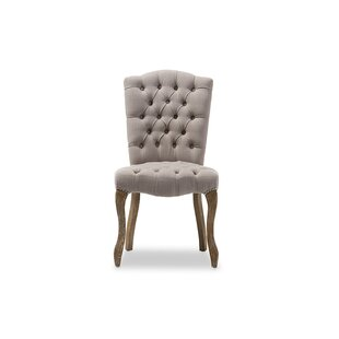 Noam Upholstered Dining Chair by One Alli..