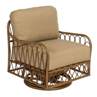 Cane Swivel Rocking Chair ..