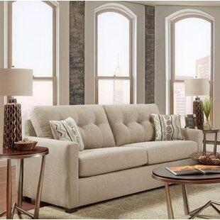 Ebern Designs Caster Tufted Sofa