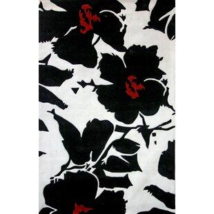 Looking for Casas Floral Black Rug ByWinston Porter