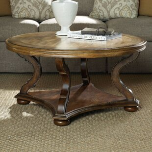 Archivist Round Coffee Table with Magazine Rack