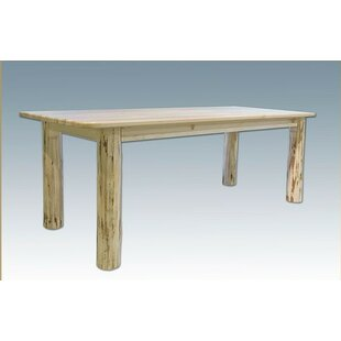 Abordale 4 Post Solid Wood Dining Table