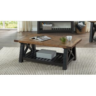 My Best Coffee Table For Living Room Is Gracie Oaks Caberfae Solid Wood Cross Legs Coffee Table With Storage