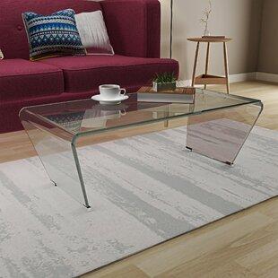 Huskins Coffee Table by Orren Ellis
