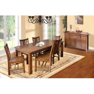 Mia 8 Piece Dining Set by Loon Peak Looking fort