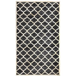 Look for Ritz Hand-Woven Black/Beige Area Rug ByDynamic Rugs