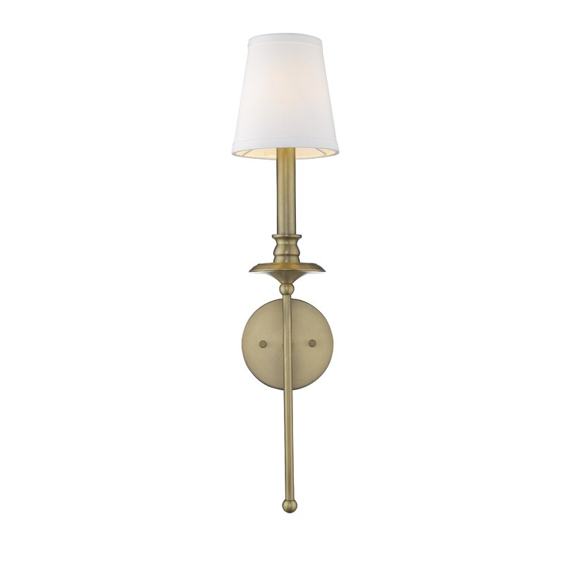 One Armed Antiqued Brass Wall Sconce With Round Back Plate